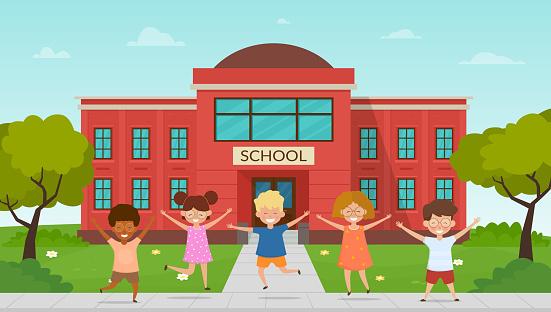 Happy children pupils having fun In front of school building.