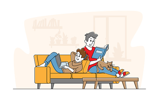 Happy Couple Relaxing Together at Home Sitting on Sofa with Book and Laptop. Male and Female Young Characters on Weekend