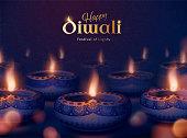 Happy diwali festival of lights with beautiful diya oil lamps on bokeh night backgound