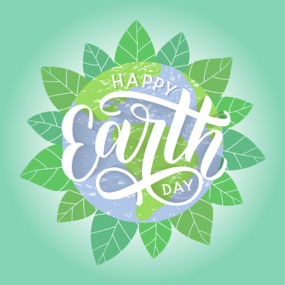 Happy Earth Day hand sketched lettering with globe and foliage on the background.