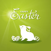 Paper cutting art of bunny and eggs for the Easter on the green background