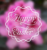 Happy Easter calligraphic headline, blurred background
