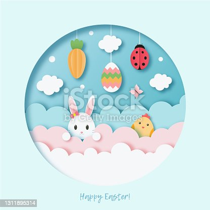 istock Happy Easter. Cute greeting card with traditional Easter symbols. Paper cur out style. 1311895314