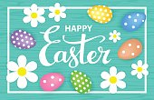 Happy easter greeting card background with paper flowers on a frame, eggs and hand lettering text