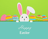 Happy easter greeting card with eggs, grass, and rabbit. Illustration