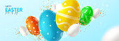 Happy Easter horizontal banner. Color eggs with Easter decoration, white eggs and golden confetti on blue background. Vector illustration with 3d decorative objects.