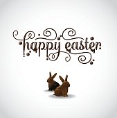 Happy Easter in fancy chocolate lettering with chocolate bunnies
