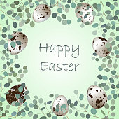Happy Easter or spring greeting card frame. Quail eggs and leaf sprigs of eucalyptus background.