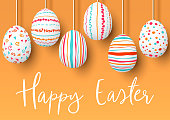 Happy Easter. pending easter eggs on golden background. Easter colorful hanging eggs with simple pink, orange, red, blue stripes, patterns, ornaments. vector illustration. Postcard template