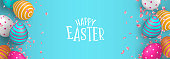 Happy Easter web banner illustration of colorful 3d eggs and spring flower petals. Realistic holiday decoration with typography quote for traditional celebration.