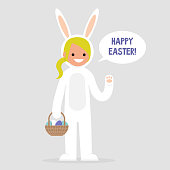 Happy easter. Young female character wearing a white bunny costume and holding a basket with dyed eggs. Holidays. Flat editable vector illustration, clip art. Culture and celebrations.