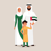 Happy family celebrating the United Arab Emirates Independence Day. Smiling Father, mother and son holding the flag of UAE.
