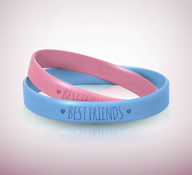 tag der glücklichen freundschaft. realistische rosa und blaue gummis freundschaftsbänder für beste freunde. - paararmbänder stock-grafiken, -clipart, -cartoons und -symbole