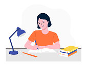 istock Happy girl studying with books. Student girl at the desk writing for her homework. Back to school. Studying on the table. Study concept. Flat vector illustration. 1262582734