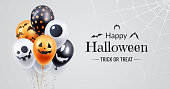 Happy halloween banner design. Halloween background with a bunch of helium balloons and spooky spiderweb in the corner. Use for party invite, greeting card, sales announcement. Vector illustration.