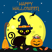 Happy Halloween. The black cat of Halloween sits against the full moon at night. Near the broom with a spider, a pumpkin with sweets, leaves, volatile vampires and stars.