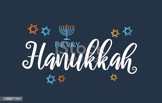 istock Happy Hanukkah lettering on blue background with menorah and stars. Vector 1289071541
