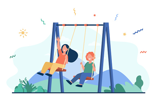 Happy kids swinging on swings