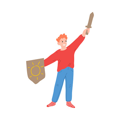 Happy little knight boy character with arm up holding wooden sword and shield. Vector illustration in cartoon style.