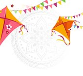 Happy Makar Sankranti holiday background with kites and bunting flags.