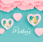 istock Happy Mother's day poster or banner with mother hug her baby in paper cut style. Shopping promotion template for mother's day. Digital craft paper art. 1219945014