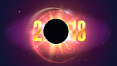 2018 Happy New Year and Marry Christmas card. Congratulation poster on space backdrop. Solar eclipse, astronomical phenomenon. Star burst with sparkles. The planet covering the Sun in eclipse