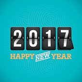 Happy New Year 2017 flip clock. EPS 10 file. Transparency effects used on highlight elements.