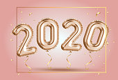Happy New Year 2020 frame. Gold foil balloons numeral 2020 and confetti on pink background. Elegant Pink Greeting celebration  poster. Golden numbers with sparkling golden confetti 3d realistic vector