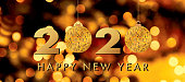 Glittering gold 2020 New Year's Eve horizontal web banner.