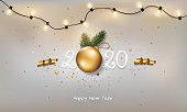 Happy new year 2020 on a white background with Christmas light and decoration.