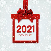 Happy New Year 2021 design, square banner in form of Christmas gift with red ribbon and bow, on winter background with snow. Greeting card, brochure or banner template. Vector illustration.