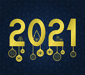 Happy new year 2021 text. Gold Figures with a Christmas tree, gifts, balls. Template for your holiday flyers, greeting and invitation cards, website headers, advertisements. Vector illustration
