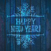 Happy New Year and Merry Christmas Lettering on wooden background