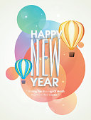 Happy New Year stylish text with colorful big bubbles and flying hot air balloon on beige backgroud.