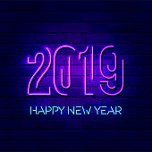 2019 Happy New Year concept with colorful neon lights. Design elements for presentations, flyers, cards, leaflets, posters or postcards. Vector Illustration. Isolated on dark blue background