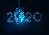 Happy New Year digital web banner template with futuristic glowing low polygonal 2020 number and planet Earth globe hanging on a ribbon bow as a decoration Christmas ball on dark blue background.