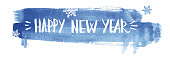 Happy new year lettering on abstract watercolor blue background