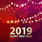 Celebrate the coming of New Year 2019 on the red background with sparkling lights