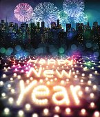 New Year's Eve with fireworks over the city. Happy new year with lights and fireworks. New Year's background with the text of the lights. Vector illustration EPS10.