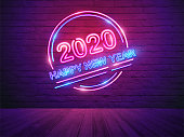 2020 happy new year with neon light alphabet on brick wall room background, Vector illustration modern design layout template