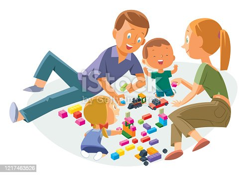 istock Happy Parents with Children Playing Game at Home 1217463526
