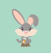 happy rabbit with carrot juice on wood