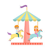 Happy red hair kids is riding at colorful horse carousel. Flat style. Vector illustration on white background