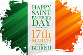 Happy Saint Patrick's Day holiday banner with irish flag colors brush stroke background. 17 march, be irish.