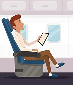 Happy smiling businessman office worker character read and relaxing in airplane business class