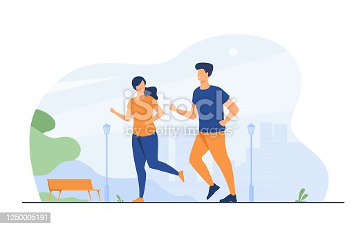 istock Happy smiling couple running at summer park 1250005191