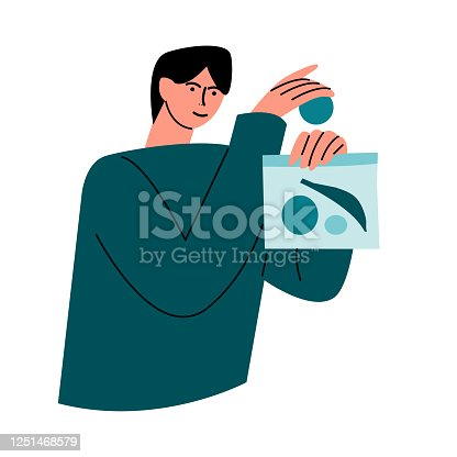 istock Happy smiling man in a green shirt packs healthy food into an eco bag. Vector illustration in cartoon style. 1251468579
