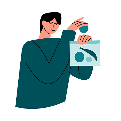 Happy smiling man in a green shirt packs healthy food into an eco bag. Vector illustration in cartoon style.
