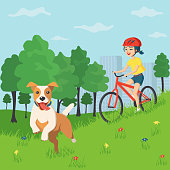 Happy smiling teenage girl rides a bicycle in a helmet in a city park. Her dog runs ahead. Summer walk in the country with a dog. Active weekend outdoors. Vector illustration in a flat cartoon style