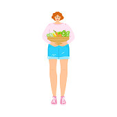 Happy smiling vegetarian girl in a pink t-shirt with a basket of fresh vegetables. Vector illustration in cartoon style